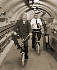 photograph of Hans Bethe and Boyce McDaniel on bicycles