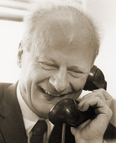 photograph of Hans Bethe on the telephone